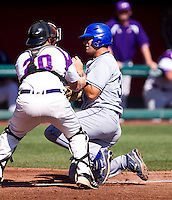 Jon Hedges (30) of the Indiana State Sycamores is tagged out at home plate during a game against the Evansville Purple Aces in the 2012 Missouri Valley Conference Championship Tournament at Hammons Field on May 23, 2012 in Springfield, Missouri. (David Welker/Four Seam Images)