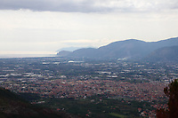Fondi: The town and its plain, characterized by quite a lot of small lakes, that broadens to the sea, betweens Sperlonga towards the South and Terracina towards to North. The panoramic photo is taken from a mountain that belongs to the Monti Aurunci Natural Park. One can distinguish, on the right, the cliff on the sea of Pisco Montano, behind which is  Monte Sant&rsquo;Angelo, where is located Terracina. Once more on the right, on the background, in the distance, there is the profile of the Monte Circeo, too. This is a slight enlargement of a part of the original image.<br />