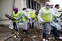 """Minamisanriku, Miyagi, Japan - The group of volunteers cleans the rubbles of public Shizugawa hospital in Minamisanriku, one year after the tsunami. The Latin group of volunteers """"Todos con Japon"""" visits Miyagi area during this Golden Week."""