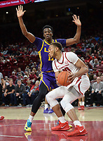 NWA Democrat-Gazette/ANDY SHUPE<br /> Arkansas forward Daniel Gafford (right) attempts a shot in the lane as he is pressured by LSU forward Kavell Bigby-Williams Friday, Jan. 11, 2019, during the first half of play in Bud Walton Arena in Fayetteville. Visit nwadg.com/photos to see more photographs from the game.
