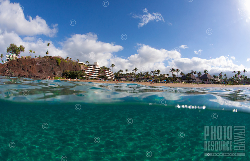 Clear water at Black Rock, Ka'anapali, Maui,  with Sheraton Hotel in the distance.