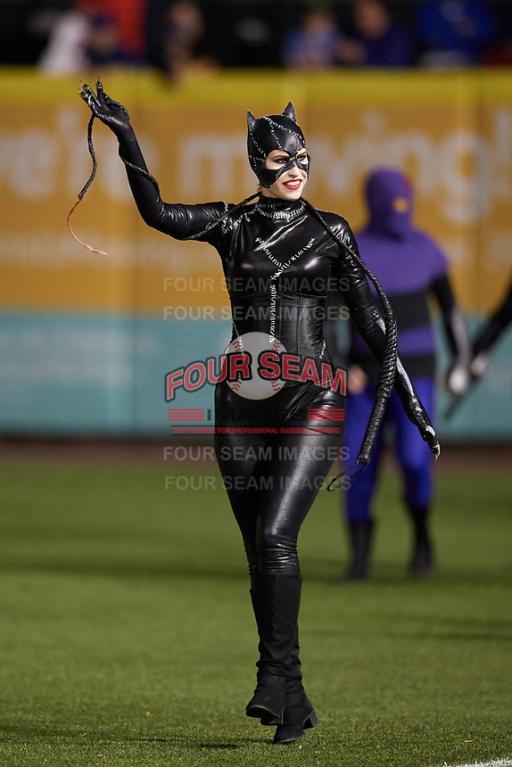 An actress portraying Catwoman enters the field for an on field performance after a Buffalo Bisons game against the Gwinnett Braves on August 19, 2017 at Coca-Cola Field in Buffalo, New York.  The Bisons wore special Superhero jerseys for Superhero Night.  Gwinnett defeated Buffalo 1-0.  (Mike Janes/Four Seam Images)