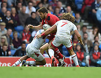 Wales's Adam Thomas is tackled by England's Daniel Norton, left, and England's Daniel Bibby<br /> <br /> Wales Vs England - men's classification 5th - 6th place match<br /> <br /> Photographer Chris Vaughan/CameraSport<br /> <br /> 20th Commonwealth Games - Day 4 - Sunday 27th July 2014 - Rugby Sevens - Ibrox Stadium - Glasgow - UK<br /> <br /> © CameraSport - 43 Linden Ave. Countesthorpe. Leicester. England. LE8 5PG - Tel: +44 (0) 116 277 4147 - admin@camerasport.com - www.camerasport.com