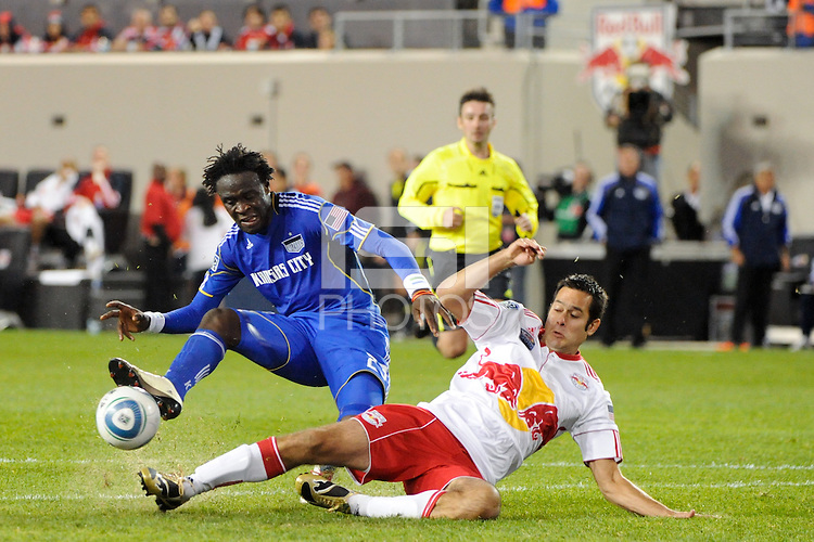 Mike Petke (12) of the New York Red Bulls tackles Kei Kamara (23) of the Kansas City Wizards. The New York Red Bulls defeated the Kansas City Wizards 1-0 during a Major League Soccer (MLS) match at Red Bull Arena in Harrison, NJ, on October 02, 2010.