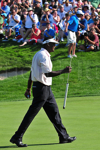28.07.2012 Vijay Singh acknowledges the 18th green crowd in the third round of the RBC Canadian Open at Hamilton Golf and Country Club in Ancaster, Ontario.