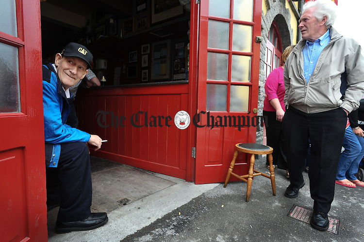 Local man Josie Downes watching the world go by from the comfort of his bar stool  during the Willie Clancy Summerschool at Miltown Malbay. Photograph by John Kelly.