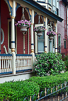 Hanging flowers on porch of victorian house, Cape May, NJ, USA