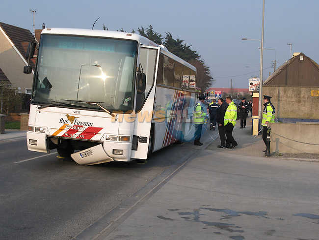 A Bus Eireann Bus involved in an accident with a young girl on the Donore Road in Drogheda. Its believed that the youngster walked out from behind a van into the oncoming path of the bus, draging the child for mearly 40 meters before comong to a stop. Drogheda fire service had to use equipment to remove the child from under the bus..Photo: Fran Caffrey/ Newsfile.