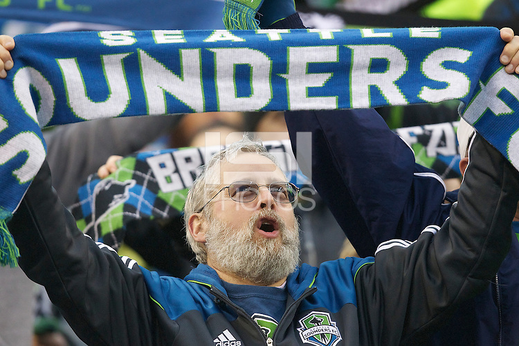 With his scarf up, a Seattle Sounders FC fan sings before play between the Seattle Sounders FC and the Houston Dynamo at Qwest Field in Seattle Friday March 25, 2011. The match ended in a 1-1 draw.