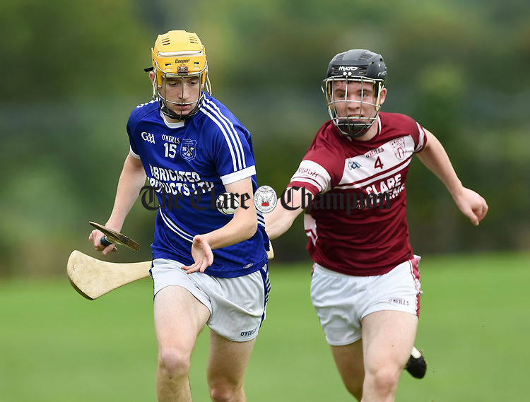 Billy Connors of Cratloe in action against Kevin Meaney of St Joseph's Doora Barefield during their round three senior championship game in Sixmilebridge. Photograph by John Kelly
