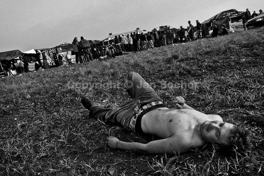 """A young man lies on the ground after dancing the whole night at Czech Free Tekno Festival """"Czarotek"""" close to Kv?tná, Czech Republic, 1 May 2009."""