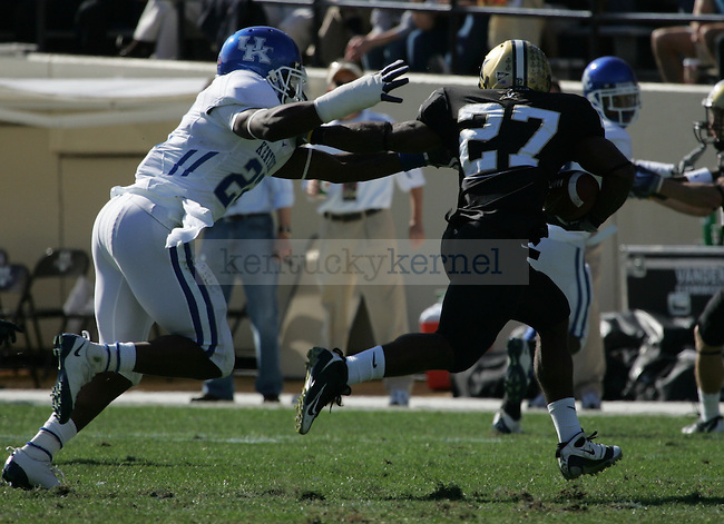 UK linebacker Danny Trevathan tackles Vanderbilt running back Warren Norman during the first half of the football game against Vanderbilt at Vanderbilt Stadium on Saturday, Nov. 14, 2009. The Wildcats beat the Commodores 24-13. Photo by Adam Wolffbrandt | Staff