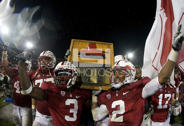 STANFORD, CA - November 19, 2011: Stanford players holding the Big Game Axe after a football game against California in Stanford, California.   Stanford won, 31-28.