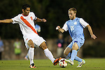 18 October 2013: North Carolina's Cooper Vandermaas-Peeler (21) and Syracuse's Nick Perea (8). The University of North Carolina Tar Heels hosted the Syracuse University Orangemen at Fetzer Field in Chapel Hill, NC in a 2013 NCAA Division I Men's Soccer match. UNC won the game 1-0.