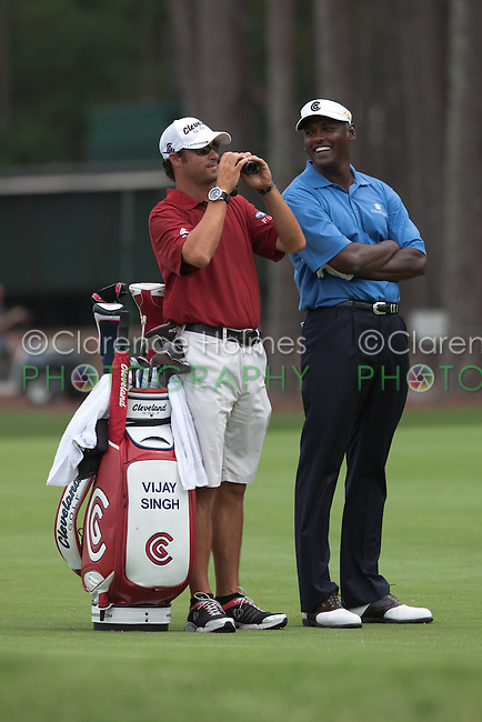 PONTE VEDRA BEACH, FL - MAY 6: Vijay Singh and caddie Chad Reynolds wait on the 16th fairway  during Vijay's practice round on Wednesday, May 6, 2009 for the Players Championship, beginning on Thursday, at TPC Sawgrass in Ponte Vedra Beach, Florida.