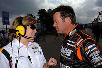 NASCAR official Jamie DiPietro talks with driver Robby Gordon (#7).