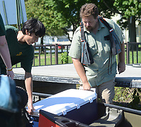 From left PJ Ngo and Vincent Cerciello load a canoe with supplies before the scouts start their journey along the Delaware River Sunday, July 30, 2017 in Burlington, New Jersey. Andrew Stillman, and his scout troop rowed to Burlington Island  to install posts with steel markers for his Eagle Scout project. They installed the posts with trail numbers at various trails to mark the trails. Until now, emergency services and the city's officials worry has been that a call for help (injury, illness) could delay response because of the size of the Island and the growth. With the trail markers - the city has helped map those trails out- EMS and the marine police will have a better chance to quickly locate someone in trouble. (Photo by William Thomas Cain)