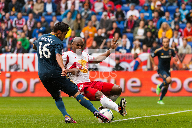 Jamison Olave (4) of the New York Red Bulls blocks the shot of Hector Jimenez (16) of the Los Angeles Galaxy. The New York Red Bulls defeated the Los Angeles Galaxy 1-0 during a Major League Soccer (MLS) match at Red Bull Arena in Harrison, NJ, on May 19, 2013.