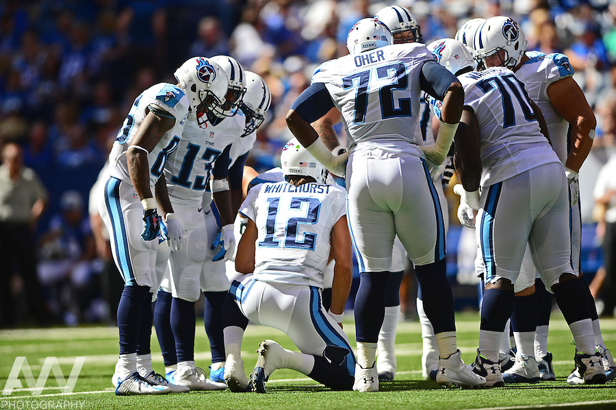 Sep 28, 2014; Indianapolis, IN, USA; Tennessee Titans quarterback Charlie Whitehurst (12) huddles the offense during the second quarter against the Tennessee Titans at Lucas Oil Stadium. Colts defeated the Titans 41-17. Mandatory Credit: Andrew Weber-USA TODAY Sports