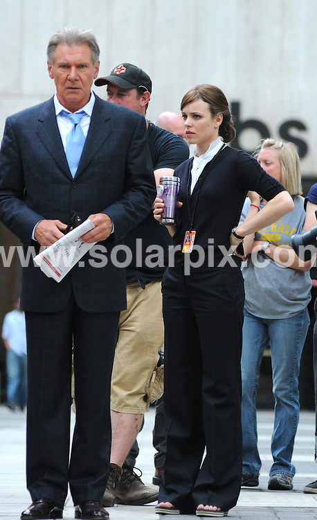 """**ALL ROUND PICTURES FROM SOLARPIX.COM**.**SYNDICATION RIGHTS FOR UK, AUSTRALIA, DENMARK, PORTUGAL, S. AFRICA, SPAIN & DUBAI (U.A.E) ONLY**.""""Morning Glory"""" Filming in Midtown Manhattan, New York, USA. June 23, 2009..This pic: Harrison Ford and Rachel McAdams..JOB REF: 9328 PHZ (Mayer)   DATE: 23_06_2009.**MUST CREDIT SOLARPIX.COM OR DOUBLE FEE WILL BE CHARGED**.**ONLINE USAGE FEE GBP 50.00 PER PICTURE - NOTIFICATION OF USAGE TO PHOTO @ SOLARPIX.COM**.**CALL SOLARPIX : +34 952 811 768 or LOW RATE FROM UK 0844 617 7637**"""