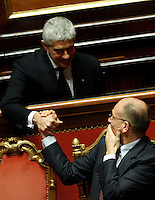 Il Presidente del Consiglio Enrico Letta, in basso, stringe la mano al leader dell'Udc Pierferdinando Casini prima del voto di fiducia sul nuovo governo al Senato, Roma, 30 aprile 2013..Italian Premier Enrico Letta, bottom, shakes hands with Udc party's leader Pierferdinando Casini prior to a confidence vote on the government at the Senate in Rome, 30 April 2013..UPDATE IMAGES PRESS/Riccardo De Luca