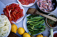 Plates of fresh ingrediants in preparation for a paella dish, Provence, France.