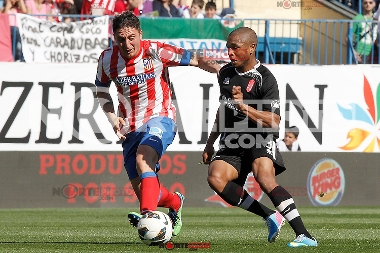 Atletico de Madrid's Cristian Cebolla Rodriguez (l) and Granada's Yacine Brahimi during La Liga match.April 14,2013. (ALTERPHOTOS/Acero)