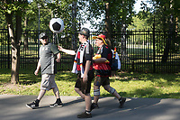 MOSCOW, RUSSIA - June 16, 2018: A German fan hands an inflatable soccer ball to a friend outside the FIFA Fan Fest at Vorobyovy Gory (Sparrow Hills) during the Iceland vs. Argentina at the 2018 FIFA World Cup.