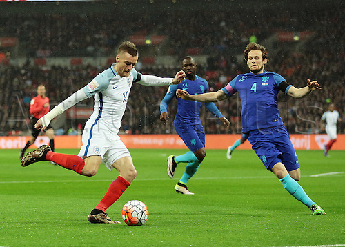 29.03.2016. Wembley Stadium, London, England.  International Football Friendly England versus Netherlands. England Forward Jamie Vardy crosses into the Netherlands area as Netherlands Defender Daley Blind looks to block