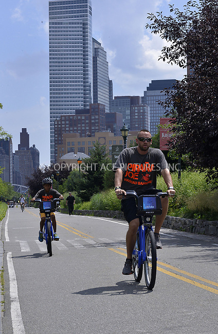 WWW.ACEPIXS.COM<br /> <br /> <br /> July 8, 2013, New York City, New York<br /> <br /> Martin Kristen and Henry out for a bike ride on July 8, 2013 in New York City.<br /> <br /> <br /> <br /> <br /> By Line: Curtis Means/ACE Pictures<br /> <br /> ACE Pictures, Inc<br /> Tel: 646 769 0430<br /> Email: info@acepixs.com