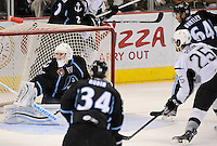 San Antonio Rampage's Colby Robak (25) shoots the puck into the top of the net over the shoulder of Milwaukee Admirals goaltender Atte Engren, left, during the first period of an AHL hockey game, Tuesday, April 10, 2012, in San Antonio. (Darren Abate/pressphotointl.com)