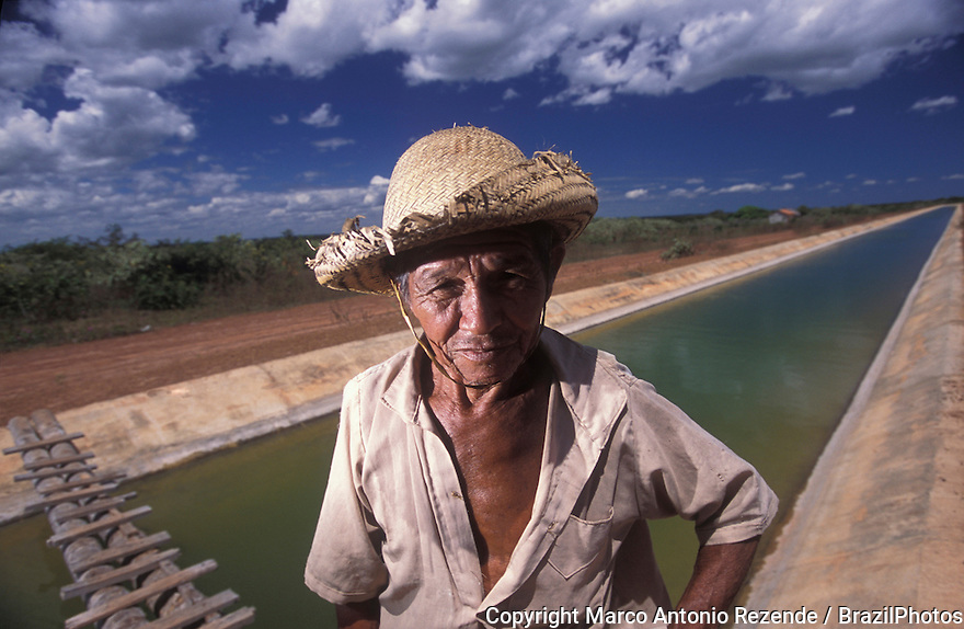 Drought. Irrigation channel. Northeastern Brazil, State: Piauí. Portary of a typical sertanejo ( man from Sertão / brazilian back country ). Transposition of the waters of a São francisco river tributary. Water for agriculture, hopeness.