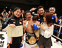 Akira Yaegashi (JPN),  Hideyuki Ohashi, Koji Matsumoto, OCTOBER 24, 2011 - Boxing : Akira Yaegashi (2nd L) of Japan celebrates with his wife Aya (2nd R), son Keitaro (R), daughter Shinobu (3rd L), Ohashi boxing gym chairman Hideyuki Ohashi (L) and trainer Koji Matsumoto (3rd R) after winning the WBA minimumweight title bout at Korakuen Hall in Tokyo, Japan. (Photo by Mikio Nakai/AFLO)