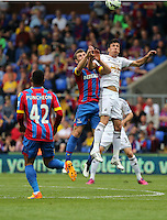 Pictured: Mile Jedinak of Crystal Palace battles for a header against Jack Cork of Swansea<br />
