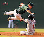 Second baseman Sean Coyle (5) of the Greenville Drive takes a tumble but applies the tag to thwart the stolen base attempt by Edward Salcedo (1) of the Rome Braves in a game on August 16, 2011, at Fluor Field at the West End in Greenville, South Carolina. (Tom Priddy/Four Seam Images)