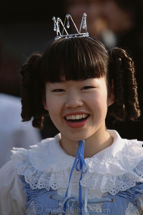 A teenage girl dressed like a schoolgirl princess at Harajuku.  Tokyo, Japan.