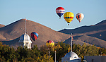 Balloons launch over downtown Carson City, Nev., on Saturday, Oct. 31, 2015. <br /> Photo by Mark Carmonne