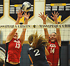 Natalie Hickman #13 of Floral Park, left, and teammate Grace Brandt #14 defend against a spike attempt by Kiersten Colvin #2 of South Side during the Nassau County varsity girls volleyball Class A semifinals at Massapequa High School on Monday, Nov. 7, 2016. Floral won 3-2.