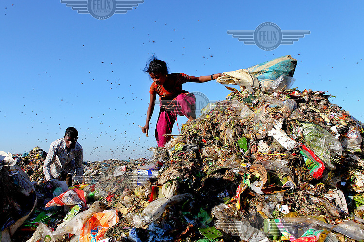 A girl look for recyclable material, to sell at a market, at the biggest rubbish dump in Dhaka. The city alone generates about 3500 to 4000 metric tons of solid waste each day.