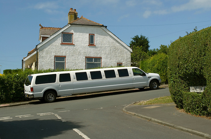 A white stretch limousine parked outside a suburban home in Brighton, England. Stretch limousines have become a regular feature of Brighton nightlife.