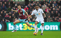 Burnley's Jack Cork battles with  Swansea City's Jordan Ayew<br /> <br /> Photographer Ashley Crowden/CameraSport<br /> <br /> The Premier League - Swansea City v Burnley - Saturday 10th February 2018 - Liberty Stadium - Swansea<br /> <br /> World Copyright &copy; 2018 CameraSport. All rights reserved. 43 Linden Ave. Countesthorpe. Leicester. England. LE8 5PG - Tel: +44 (0) 116 277 4147 - admin@camerasport.com - www.camerasport.com