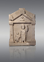 Roman relief funereal stele from Hierapolis Northern Necropolis. Hierapolis Archaeology Museum, Turkey. Against a grey background