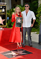 LOS ANGELES, CA. September 20, 2018: Carrie Underwood &amp; Simon Cowell at the Hollywood Walk of Fame Star Ceremony honoring singer Carrie Underwood.<br /> Pictures: Paul Smith/Featureflash
