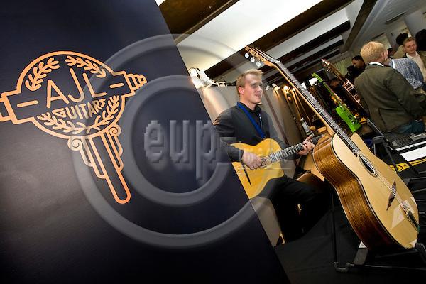 BRUSSELS - BELGIUM - 26 OCTOBER 2008 -- Bosella Guitar Fair in Heysel Expo. -- Henrik Katto entertaining clientele at the AJL Guitars stand. -- PHOTO: JUHA ROININEN / EUP-IMAGES