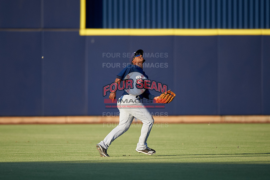 AZL Brewers Blue left fielder Jackie Urbaez (8) prepares to catch a fly ball during an Arizona League game against the AZL Brewers Gold on July 13, 2019 at American Family Fields of Phoenix in Phoenix, Arizona. The AZL Brewers Blue defeated the AZL Brewers Gold 6-0. (Zachary Lucy/Four Seam Images)