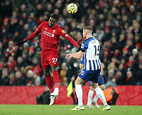 30th November 2019; Anfield, Liverpool, Merseyside, England; English Premier League Football, Liverpool versus Brighton and Hove Albion; Divock Origi of Liverpool wins a header challenged by Adam Webster of Brighton and Hove Albion - Strictly Editorial Use Only. No use with unauthorized audio, video, data, fixture lists, club/league logos or 'live' services. Online in-match use limited to 120 images, no video emulation. No use in betting, games or single club/league/player publications