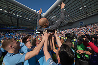 Manchester City players celebrating with  manager Josep Guardiola <br /> <br /> Photographer David Horton/CameraSport<br /> <br /> The Premier League - Brighton and Hove Albion v Manchester City - Sunday 12th May 2019 - The Amex Stadium - Brighton<br /> <br /> World Copyright © 2019 CameraSport. All rights reserved. 43 Linden Ave. Countesthorpe. Leicester. England. LE8 5PG - Tel: +44 (0) 116 277 4147 - admin@camerasport.com - www.camerasport.com
