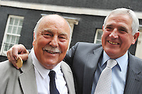 June 11, 2009. Eleven members of England's 1966 World Cup-winning squad have finally received their winners medals - 43 years after the match. The former players attended a reception at 10 Downing Street and were presented with the medals by Prime Minister Gordon Brown. Picture shows Jimmy Greaves outside of number 10 Downing Street with his medal and fellow team mate Norman Hunter ex of Leeds United.