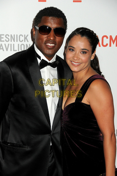 "KENNETH 'BABYFACE' EDMONDS & NICOLE PATENBURG .LACMA's ""The Unmasking"" of the Lynda & Stewart Resnick Exhibition Pavilion Opening Gala held at the Los Angeles County Museum of Art, - Los Angeles, California, USA, 25th September 2010..half length couple  velvet purple dress black tuxedo tux bow tie sunglasses aubergine .CAP/ADM/BP.©Byron Purvis/AdMedia/Capital Pictures."