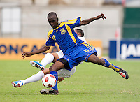 Carlos Valentin (15) of Honduras is tackled by Jabarry Chandler (11) of Barbados  during the group stage of the CONCACAF Men's Under 17 Championship at Catherine Hall Stadium in Montego Bay, Jamaica. Honduras defeated Barbados, 2-1.